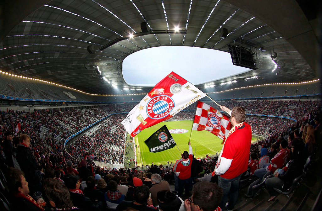 . Supporters of Bayern Munich wave flags during a public viewing event at Munich\'s stadium May 25, 2013, of the Champions League soccer final between Bayern Munich and Borussia Dortmund at Wembley in London.   REUTERS/Michaela Rehle