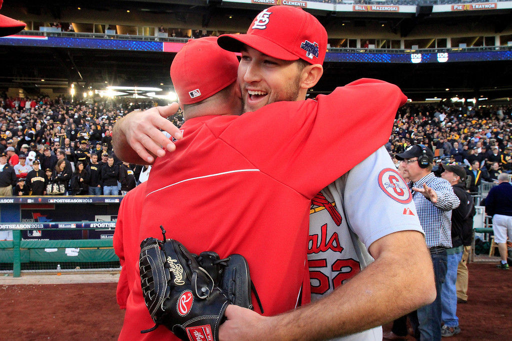 . St. Louis Cardinals pitcher Michael Wacha, right, celebrates with teammates after a 2-1 win over the Pittsburgh Pirates in Game 4 of a National League baseball division series, Monday, Oct. 7, 2013, in Pittsburgh. (AP Photo/Gene J. Puskar)
