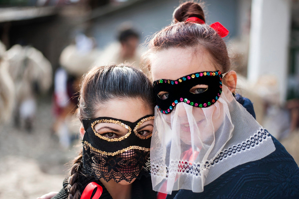 . Young revelers wearing masks get ready for the traditional carnival parade in the yard of a house in Mohacs, 189 kms south of Budapest, Hungary, 27 February 2014.   EPA/TAMAS SOKI