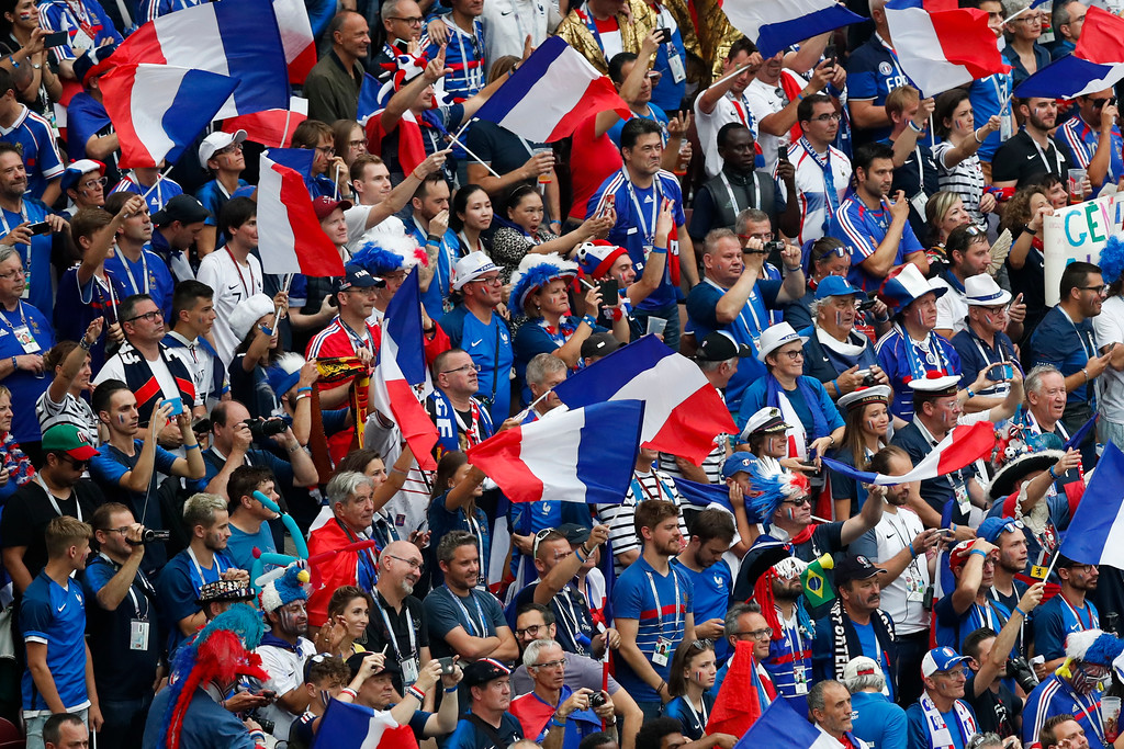 . France fans chant during the final match between France and Croatia at the 2018 soccer World Cup in the Luzhniki Stadium in Moscow, Russia, Sunday, July 15, 2018. (AP Photo/Rebecca Blackwell)