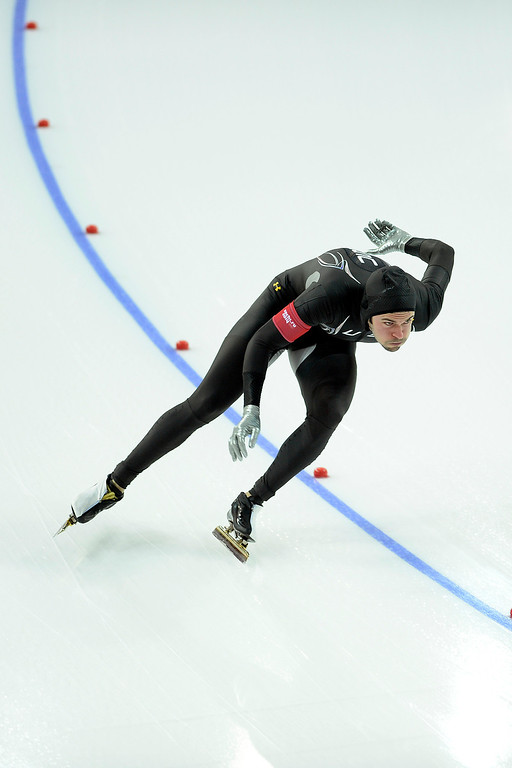 . U.S.A. skater Mitchell Whitmore makes his first turn during the speed skating men\'s 500-meter at Adler Arena. Sochi 2014 Winter Olympics on Monday, February 10, 2014. (Photo by AAron Ontiveroz/The Denver Post)