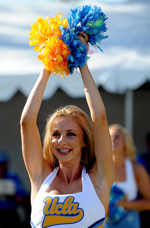 . A UCLA cheerleader performs prior to a college football game between Nevada and UCLA in the Rose Bowl on Saturday, Aug. 31, 2013 in Pasadena, Calif.    (Keith Birmingham Pasadena Star-News)