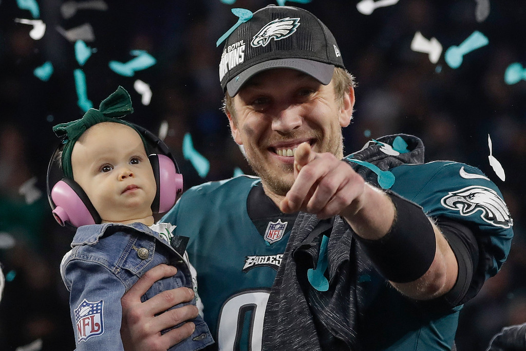 . Philadelphia Eagles\' Nick Foles holds his daughter Lily after the NFL Super Bowl 52 football game against the New England Patriots, Sunday, Feb. 4, 2018, in Minneapolis. The Eagles won 41-33. (AP Photo/Matt Slocum)