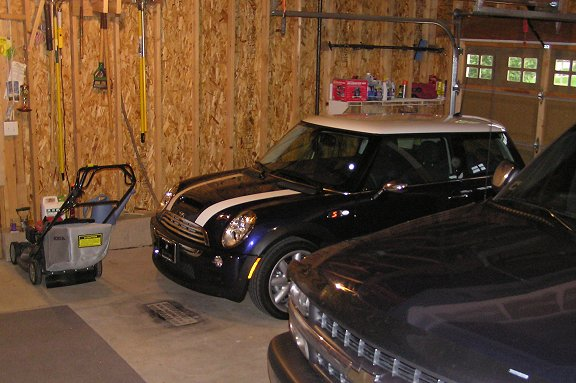 A view of the MINI the next morning, resting in the 3rd garage bay. The lawn mower was not too happy about having to scoot over for the new kid.