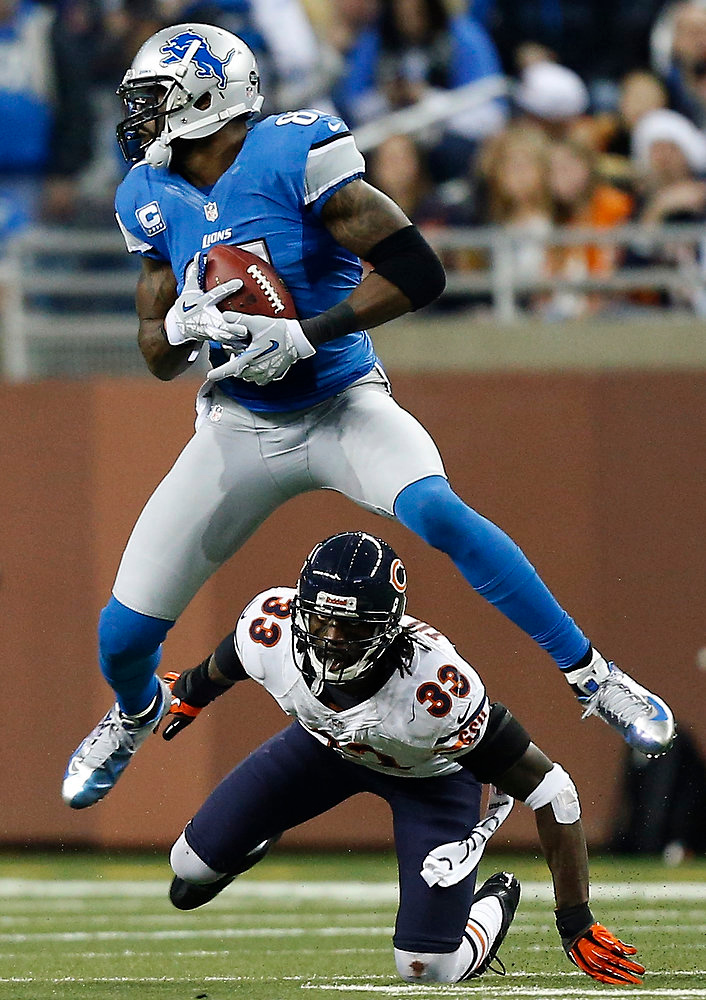 . Detroit Lions wide receiver Calvin Johnson (81) gains 18-yards on a pass reception under pressure from Chicago Bears cornerback Charles Tillman (33) during the third quarter of an NFL football game at Ford Field in Detroit, Sunday, Dec. 30, 2012. (AP Photo/Rick Osentoski)