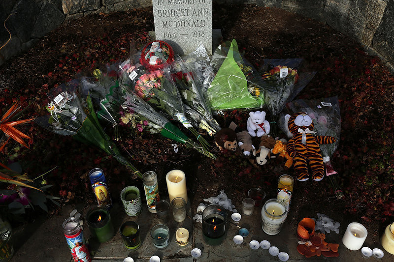 . Flowers, stuffed animals and candles are at a memorial outside of a church where residents have come to pray and reflect on the violence at the Sandy Hook Elementary School on December 15, 2012 in Newtown, Connecticut. Twenty six people were shot dead, including twenty children, after a gunman identified as Adam Lanza opened fire in the school. Lanza also reportedly had committed suicide at the scene. A 28th person, believed to be Nancy Lanza was found dead in a house in town, was also believed to have been shot by Adam Lanza.  (Photo by Spencer Platt/Getty Images)