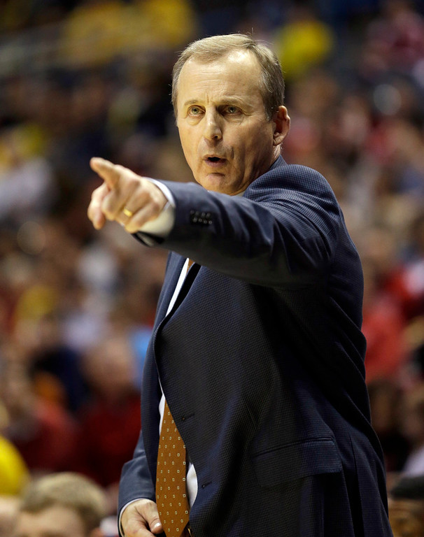 . Texas head coach Rich Barnes directs his team during the first half of a third-round game against the Michigan of the NCAA college basketball tournament Saturday, March 22, 2014, in Milwaukee. (AP Photo/Morry Gash)