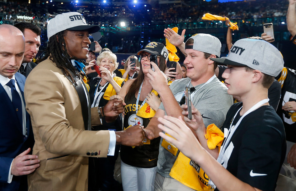 . Virginia Tech\'s Terrell Edmunds celebrates with Pittsburgh Steelers fans during the first round of the NFL football draft, Thursday, April 26, 2018, in Arlington, Texas. (AP Photo/Michael Ainsworth)