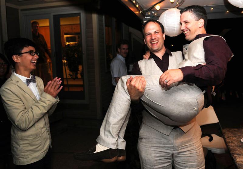 . Bradley Weber picks up husband Ryan Pfeifle to show their son Kyle Pfeifle-Weber, 13, that Bradley can still pick him up. (Pioneer Press: Sherri LaRose-Chiglo)