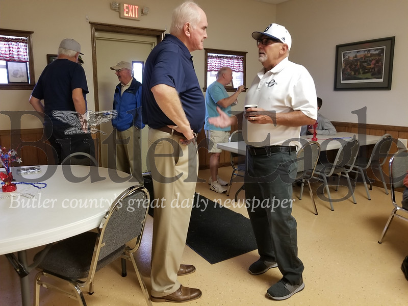 Attendee Larry Sassone of Butler talks with U.S. Rep. Mike Kelly about current political issues at an event on Saturday at the American Legion 778 in Lyndora.