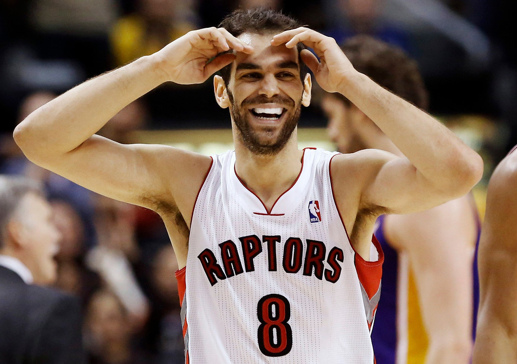 . Toronto Raptors\' Jose Calderon smiles during a break against the Los Angeles Lakers during the second half of their NBA basketball game in Toronto, January 20, 2013. REUTERS/Mark Blinch