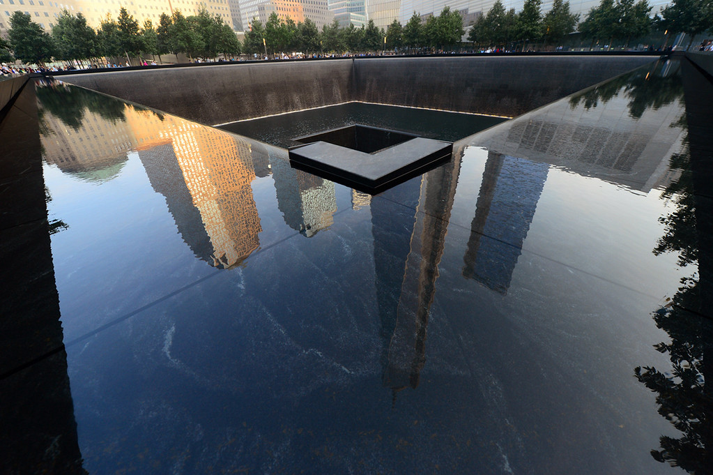 . Building are reflected in one of the pools of the 9/11 Memorial during ceremonies for the twelfth anniversary of the terrorist attacks on lower Manhattan at the World Trade Center site on September 11, 2013 in New York City.  (Photo by Alejandra Villa-Pool/Getty Images)