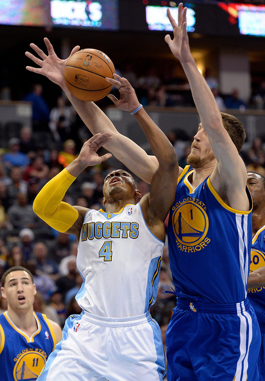 . DENVER, CO - APRIL 16: Denver Nuggets guard Randy Foye (4) gets the ball slapped away by Golden State Warriors center Ognjen Kuzmic (1) during the fist quarter April 16, 2014 at Pepsi Center. (Photo by John Leyba/The Denver Post)