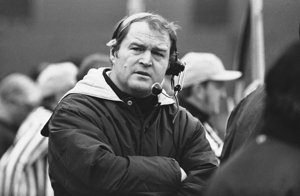 . Pittsburgh Steelers head coach Chuck Noll, left, keeps in touch with his spotters during game against the Oakland Raiders in the American Conference playoff game in Pittsburgh, Dec. 23, 1972. John Madden, right, Oakland Raiders head coach puts hand to face watching. (AP Photo)