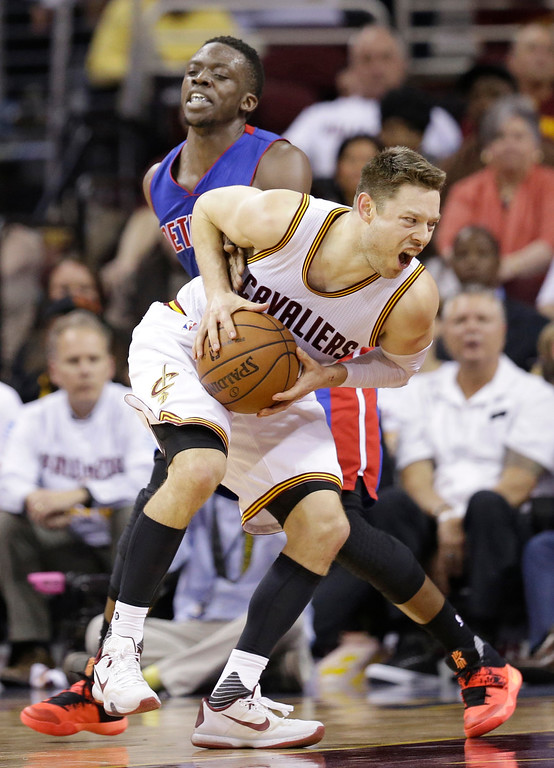 . Cleveland Cavaliers\' Matthew Dellavedova, front, is fouled by Detroit Pistons\' Reggie Jackson, back, during the second half in Game 2 of a first-round NBA basketball playoff series, Wednesday, April 20, 2016, in Cleveland. The Cavaliers won 107-90. (AP Photo/Tony Dejak)