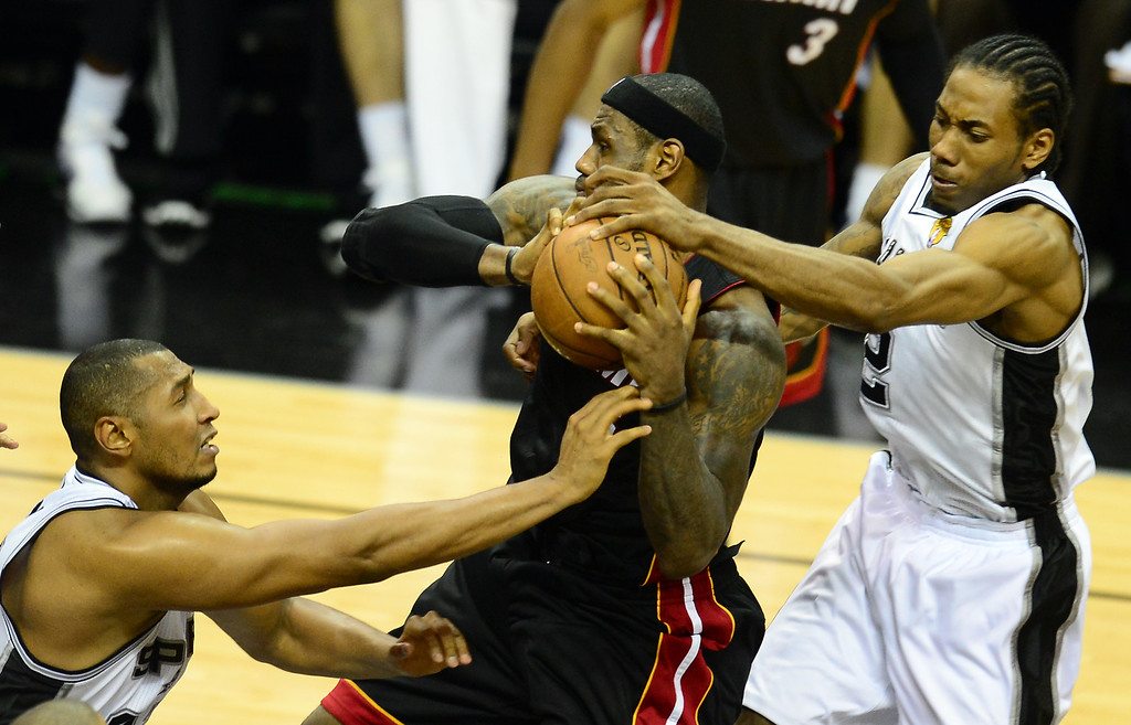 . LeBron James of the Miami Heat vies for the ball with Boris Diaw and Kawhi  Leonard of the San Antonio Spurs during game 5 of the NBA finals on June 16, 2013 in San Antonio, Texas., where the Spurs defeated the Heat 114-104 and now lead the series 3-2.   FREDERIC J. BROWN/AFP/Getty Images