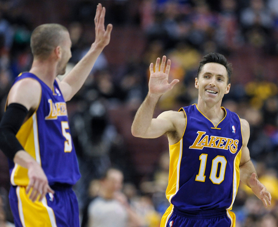 . Los Angeles Lakers\' Steve Nash (10) celebrates with teammate Steve Blake after scoring a basket during the second half of an NBA basketball game on Friday, Feb. 7, 2014, in Philadelphia.  (AP Photo/Michael Perez)