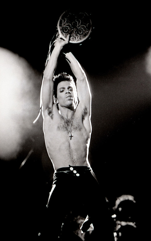 . Pop star Prince performs during a tour stop in Denver at McNichols Arena July, 3, 1986. The pop star died Thursday morning at his Paisley Park estate in suburban Minneapolis April 21, 2016 according to his publicist. He was 57.   (Photo By John Leyba/The Denver Post)
