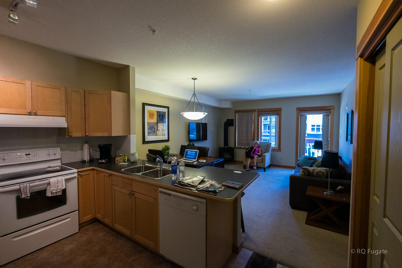 View of the kitchen and living room in the Canmore Condo.