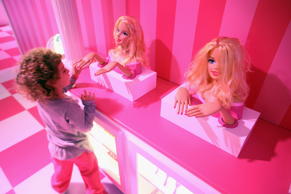 . Tamar, 4, who is visiting with her mother from Israel, looks at Barbie busts at the Barbie Dreamhouse Experience on May 16, 2013 in Berlin, Germany. The Barbie Dreamhouse is a life-sized house full of Barbie fashion, furniture and accessories and will be open to the public until August 25 before it moves on to other cities in Europe.  (Photo by Sean Gallup/Getty Images)