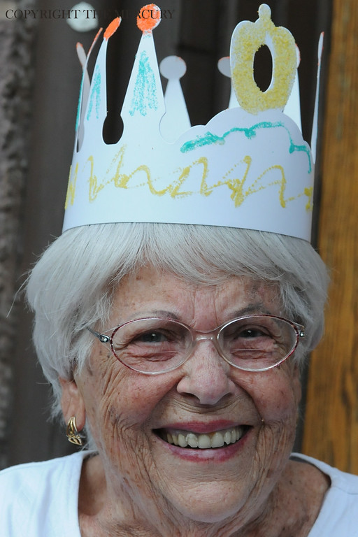 . Elaine Huss wears a crown that she made at Trinity U.C.C. at Hanover and King St. enjoying the National Night Out events in Pottstown. Photo by John Strickler The Mercury
