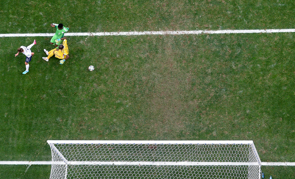. Nigeria\'s Joseph Yobo, top, scores an own goal during the World Cup round of 16 soccer match between France and Nigeria at the Estadio Nacional in Brasilia, Brazil, Monday, June 30, 2014. France won 2-0 and advances to the quarterfinal. (AP Photo/Francois Xavier Marit, pool)