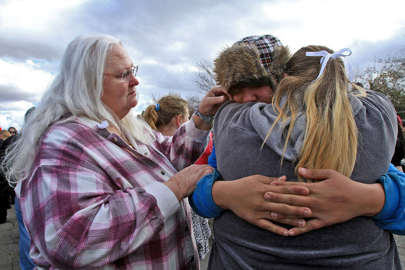 . Jacob Jackson, 15, hugs his mother Mary Jackson, 36, and grandmother Sandy Jackson, 57, looks on after being safely reunited at Taft Union High School in Kern County, California, on Thursday, January 10, 2013, after a student opened fire in a classroom. (Irfan Khan/Los Angeles Times/MCT)