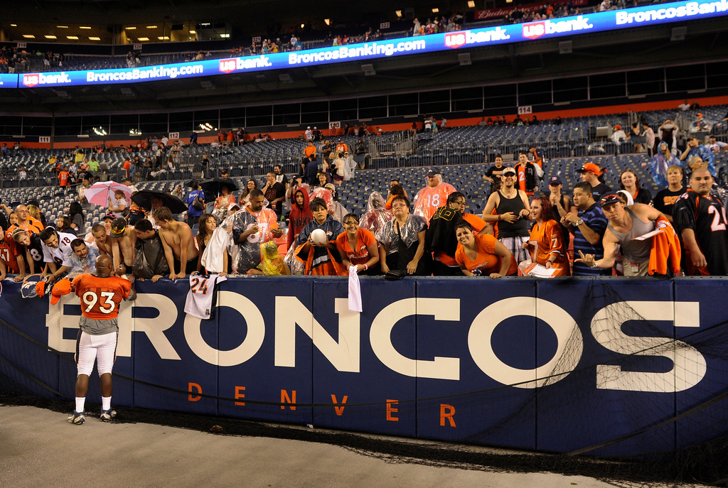 . DENVER, CO. - AUGUST 03: Defensive end Jeremy Beal stuck around to sign for fans Saturday night. The Denver Broncos signed autographs for fans after practicing in the rain at Sports Authority Field Saturday night, August 3, 2013. Photo By Karl Gehring/The Denver Post