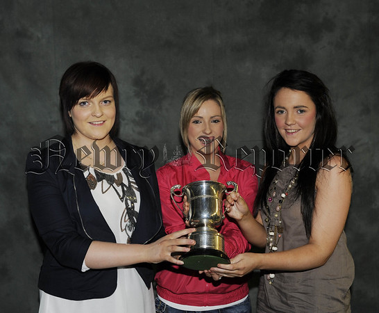 Aine Nolan, Denise Rowland and Aisleen Tierney receive the Archie McMullan Cup for Academic Achievement 10W45N612