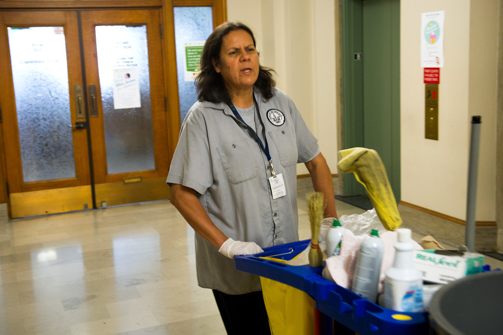 . Custodian Sanjuana Salas pushes her cleaning cart through the eighth floor at L.A. City Hall, Tuesday, March 18, 2014. (Photo by Michael Owen Baker/L.A. Daily News)