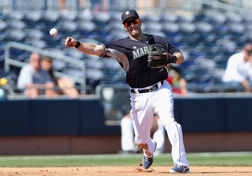 . Infilder Willie Bloomquist #8 of the Seattle Mariners fields a ground ball out against the Colorado Rockies during the spring training game at Peoria Stadium on March 3, 2014 in Peoria, Arizona.  (Photo by Christian Petersen/Getty Images)