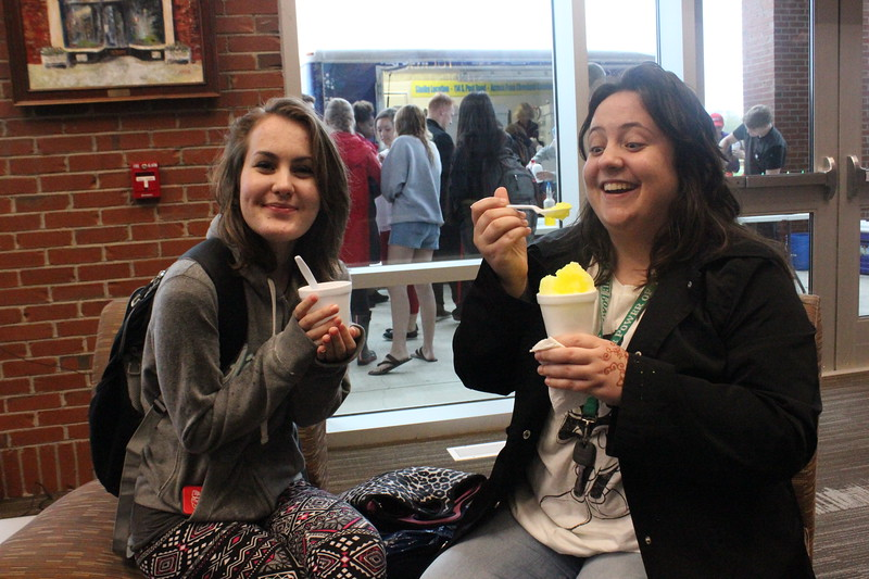 Haddie Winters and Jenna Shackelford trudged through the rain to get a Pelican's Snowball.