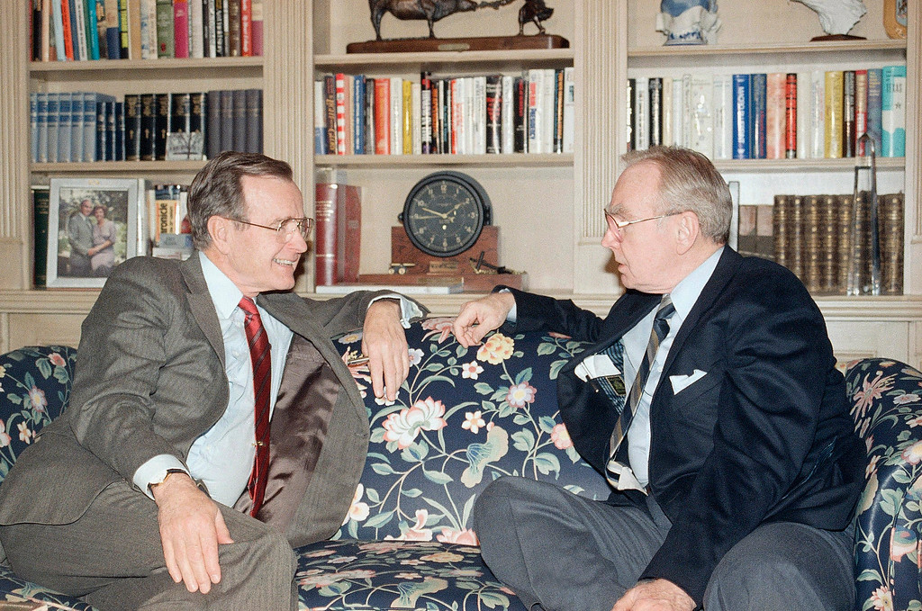 . U.S. President George H. Bush talks with House Speaker Jim Wright, D-Texas, on Capitol Hill, Tuesday, Feb. 8, 1989 in Washington after the House voted to reject a 51-percent pay raise. The Senate followed suit and did the same later in the day. Bush signed the measure canceling the proposed wage hike. (AP Photo/Barry Thumma)