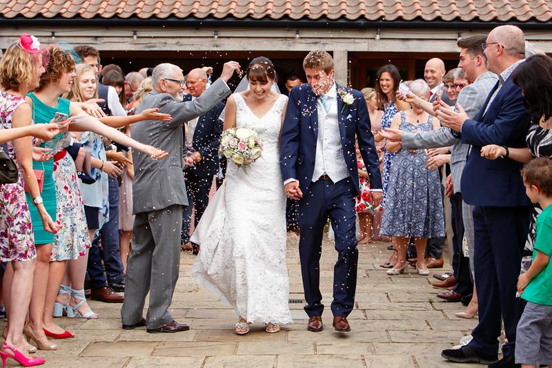 wedding-photographer-eastongrange-suffolk-confetti-(37).jpg