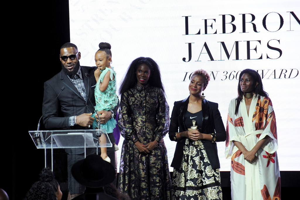 . Basketball star LeBron James, holds his daughter Zhuri, as he accepts the Harlem Fashion Row\'s ICON 360 Award for his contribution to fashion and philanthropy at the HFR fashion show and awards ceremony before the start of New York Fashion Week, Tuesday, Sept. 4, 2018. (AP Photo/Diane Bondareff)