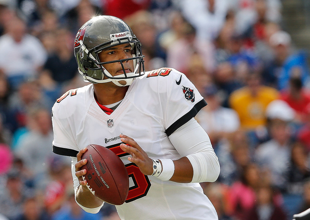 . Josh Freeman #5 of the Tampa Bay Buccaneers looks for an open man in the second half against the New England Patriots at Gillette Stadium on September 22, 2013 in Foxboro, Massachusetts. (Photo by Jim Rogash/Getty Images)