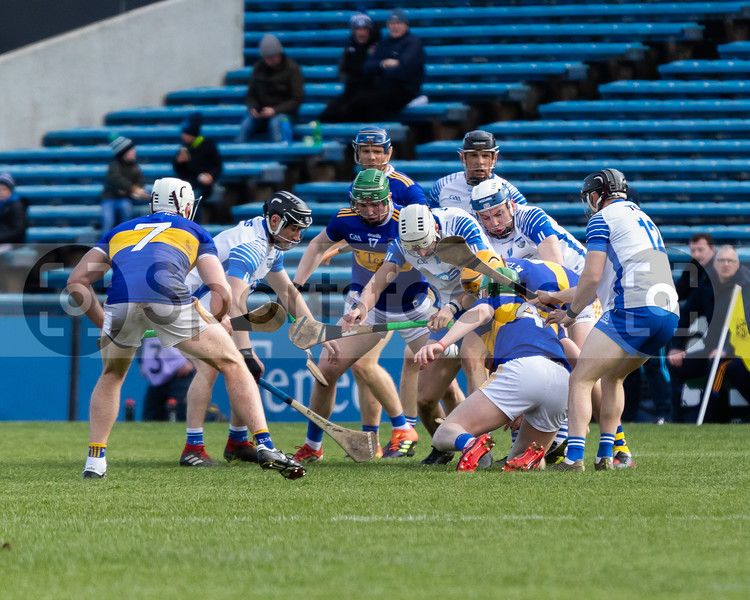 Several Tipperary and Waterford hurlers scramble for the sliotar