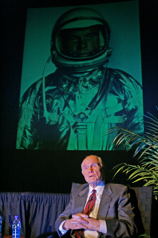 . Former astronaut and senator John Glenn, 85, speaks at a museum exhibition marking the 45th anniversary of the space flight that made him the first American to orbit Earth Tuesday, Feb. 20, 2007, in Columbus, Ohio. A large sized photograph of him in his space suit is behind. (AP Photo/Kiichiro Sato)