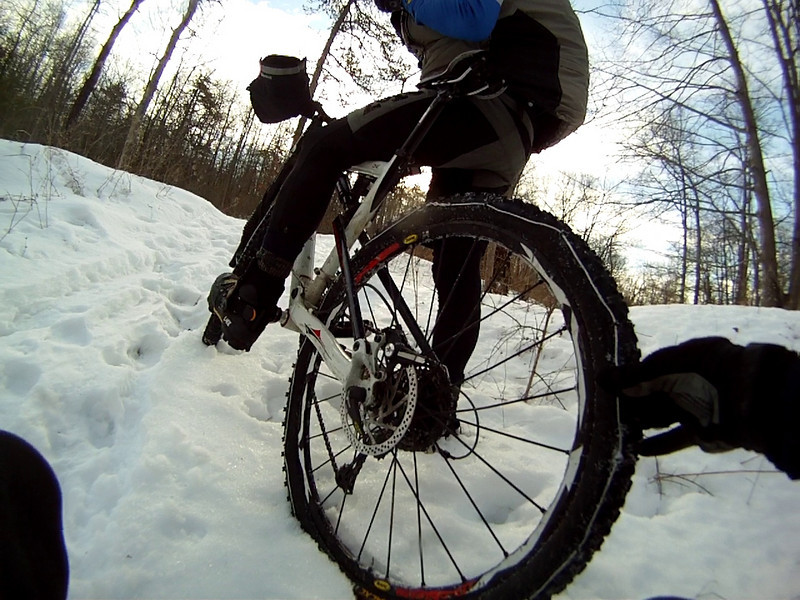 SNOW TIRES ona Mountain Bike? Yep! Jim Potts with the help of his local hardware store came up with these babbies. He found traction on patches of ice while at times we watched from the ground.