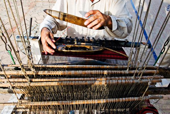 a craftsman weaving cloth