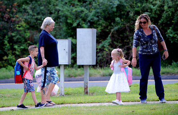 8/28/2019 Mike Orazzi | Staff Lisa Krajza holds her grandson Blakes hand as he and his sister Quinn head back to school on the first day back to school at the Plymouth Center School on Wednesday morning. On the right is their mom Amy Swiatlon.