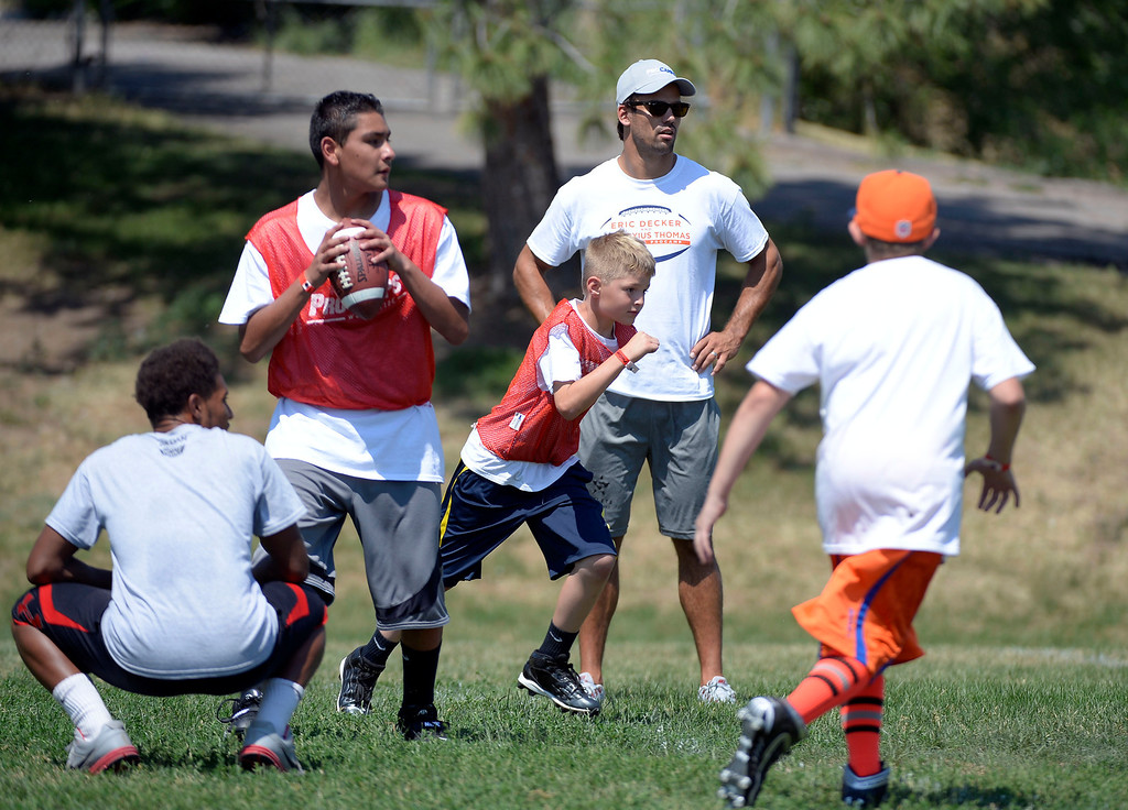 . Eric Decker watches one of the games played at football camp. Demaryius Thomas and Eric Decker team up with ProCamps for their football camp held at Littleton High School July 11, 2013.  (Photo By John Leyba/The Denver Post)