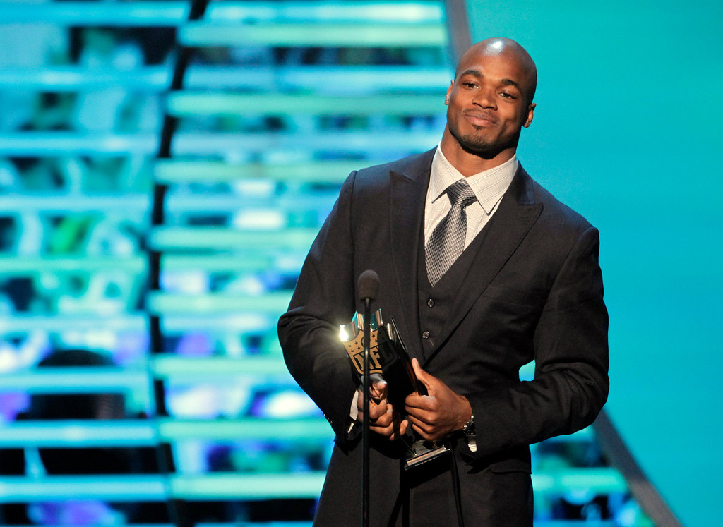 . Adrian Peterson of the Minnesota Vikings accepts the AP Most Valuable Player award presented by Papa John\'s at the 2nd Annual NFL Honors on Saturday, Feb. 2, 2013 in New Orleans. (Photo by AJ Mast/Invision/AP)