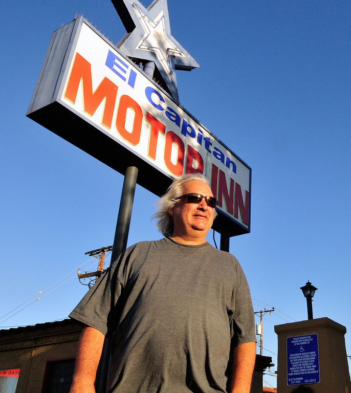 . Tim Grobaty poses near the sign advertising the El Capitan Motor InnPhoto by Thomas Wasper for the Press Telegram