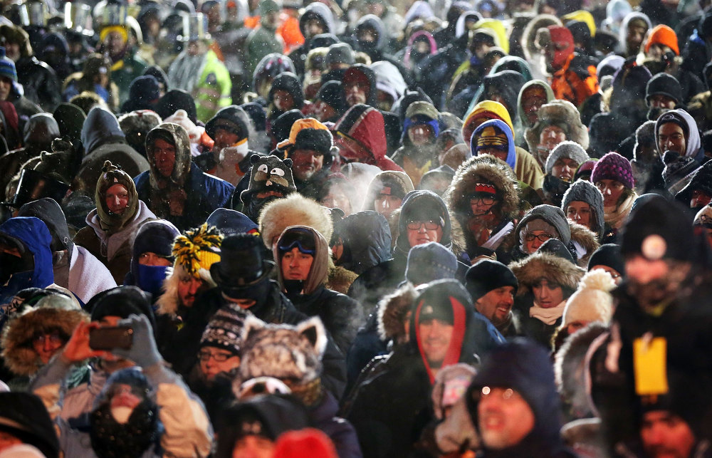 Description of . A crowd waits for the Punxsutawney Phil to come out from his winter den during the 127th Groundhog Day Celebration at Gobbler's Knob on February 2, 2013 in Punxsutawney, Pennsylvania. The Punxsutawney 'Inner Circle' claimed that there were about 35,000 people gathered at the event to watch Phil's annual forecast.  (Photo by Alex Wong/Getty Images)