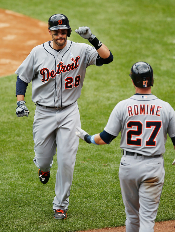 . Detroit Tigers J.D. Martinez (28) celebrates with Tigers Andrew Romine (27) after hitting a fifth-inning, solo, home run in a baseball game at Yankee Stadium in New York, Sunday, June 21, 2015. (AP Photo/Kathy Willens)