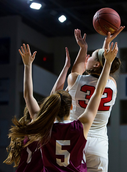BANGOR, Maine -- 03/04/2017 -- Dexter's Megan Peach (right) puts up a shot past Monmouth's Emily Grandahl during their Class C girls basketball state championship at the Cross Insurance Center in Bangor Saturday. Ashley L. Conti | BDN