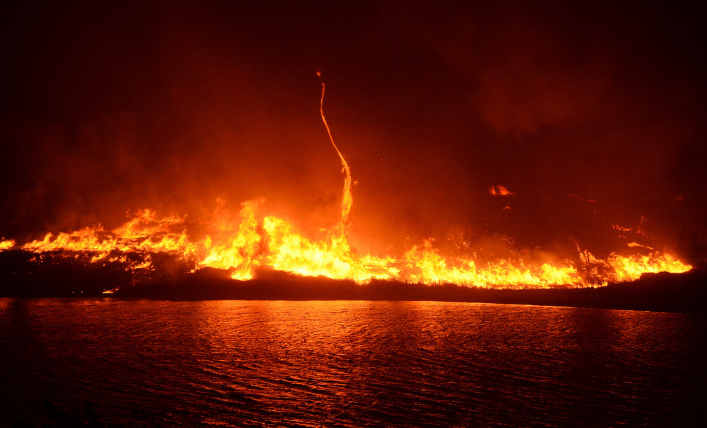 . Fire surrounds the lake as the Powerhouse Fire enters its fourth day early Sunday, June 2, 2013, in the Angeles National Forest near the Lake Hughes area. (Gene Blevins/L.A. Daily News)