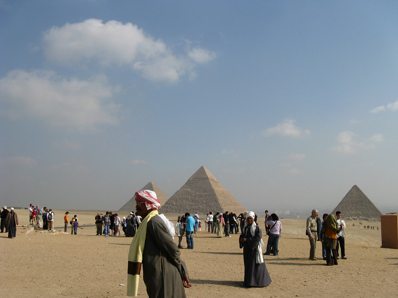 The pyramids from a distance. We were there at the peak of tourist season so everything is crowded.
