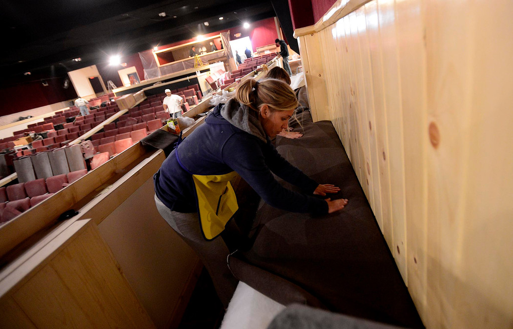 . Danielle Loper works on upholstering bench seating in The Cave Theater in Big Bear Lake May 6, 2013.  The music venue, which was originally a movie theater, is set for a grand re-opening for June 7.  GABRIEL LUIS ACOSTA/STAFF PHOTOGRAPHER.